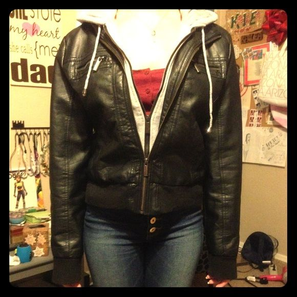 Black leather jacket w/ built in hoodie/sweatshirt The sweatshirt is only for the hoodie and second zipper and not actually a whole sweatshirt but completes the look of the leather jacket. Only worn once. Rue 21 Jackets & Coats