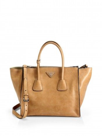 816a14b5af1e Prada Glace Calf Twin Pocket Tote in Natural worn by #OliviaPope on #Scandal