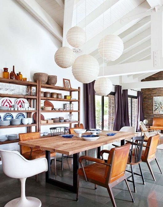 cluster of white paper lanterns hung over wood dining table ...