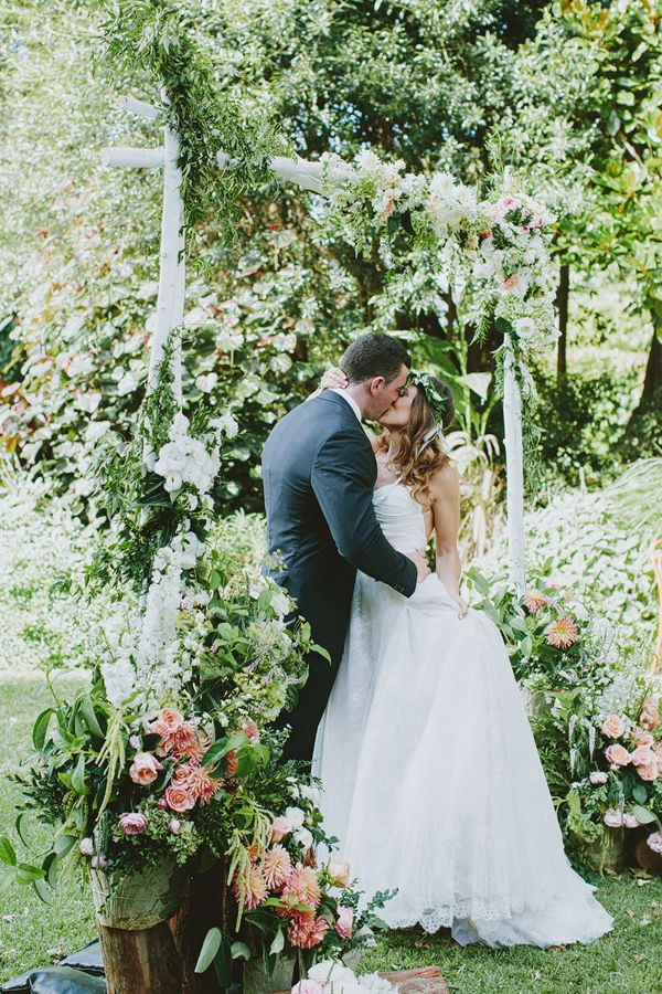 flower-filled bohemian wedding arch - photography by I Love Wednesdays