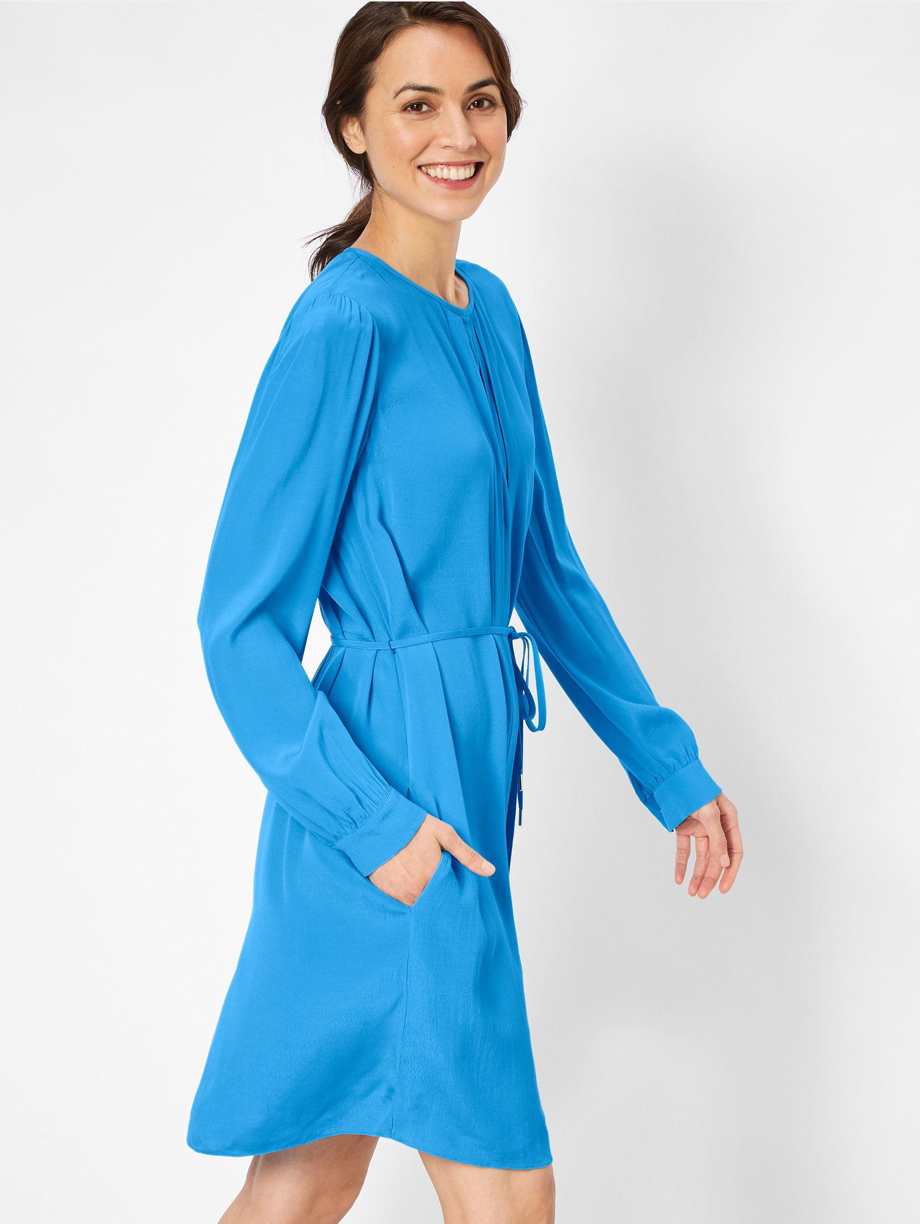 Dieses Kleid in starkem Blau mit langen Ärmeln ist ein ...