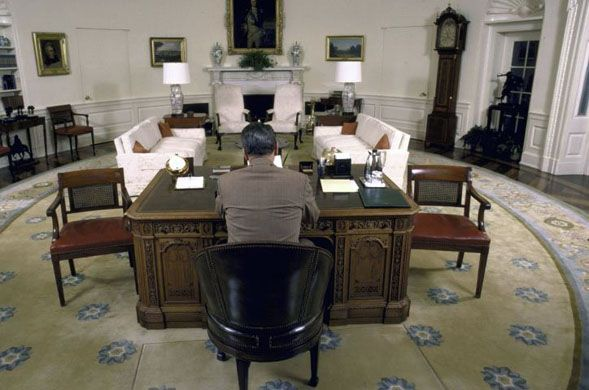 the oval office. President Ronald Reagan Sitting At The Resolute Desk In Oval Office 1987.