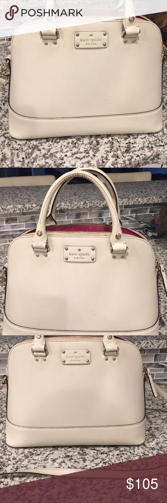 Kate Spade Cream handbag Satchel with zip top closure. Double slide pockets and a zipper pocket. Pink lining. Kate spade gold embossed signature. Bags Satchels