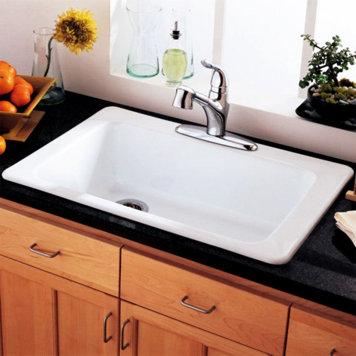 Bushboard\'s Encore solid surface in Ivory Glass shown with Franke ...