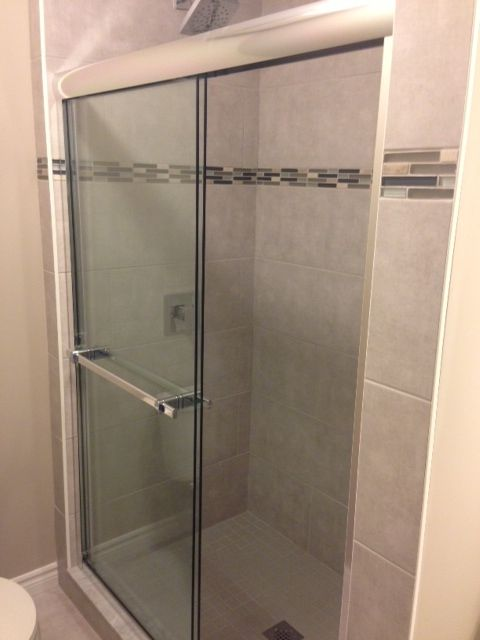 Sliding Walk In Shower Doors.Walk In Tiled Shower With Sliding Glass Doors And Shampoo