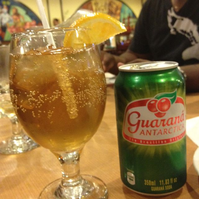 """Guaraná - Soft drink based on an Amazonian fruit.  It's like cola here in that there are like 1,000 different companies that make it, but a few stand out (Antarctica is widely considered the best, followed by Kuat in my opinion).  After my first can, I thought """"well, that was different;"""" after my second, I thought """"this is without doubt the best soft drink on the planet.""""  I stand by that.  So have at least two."""