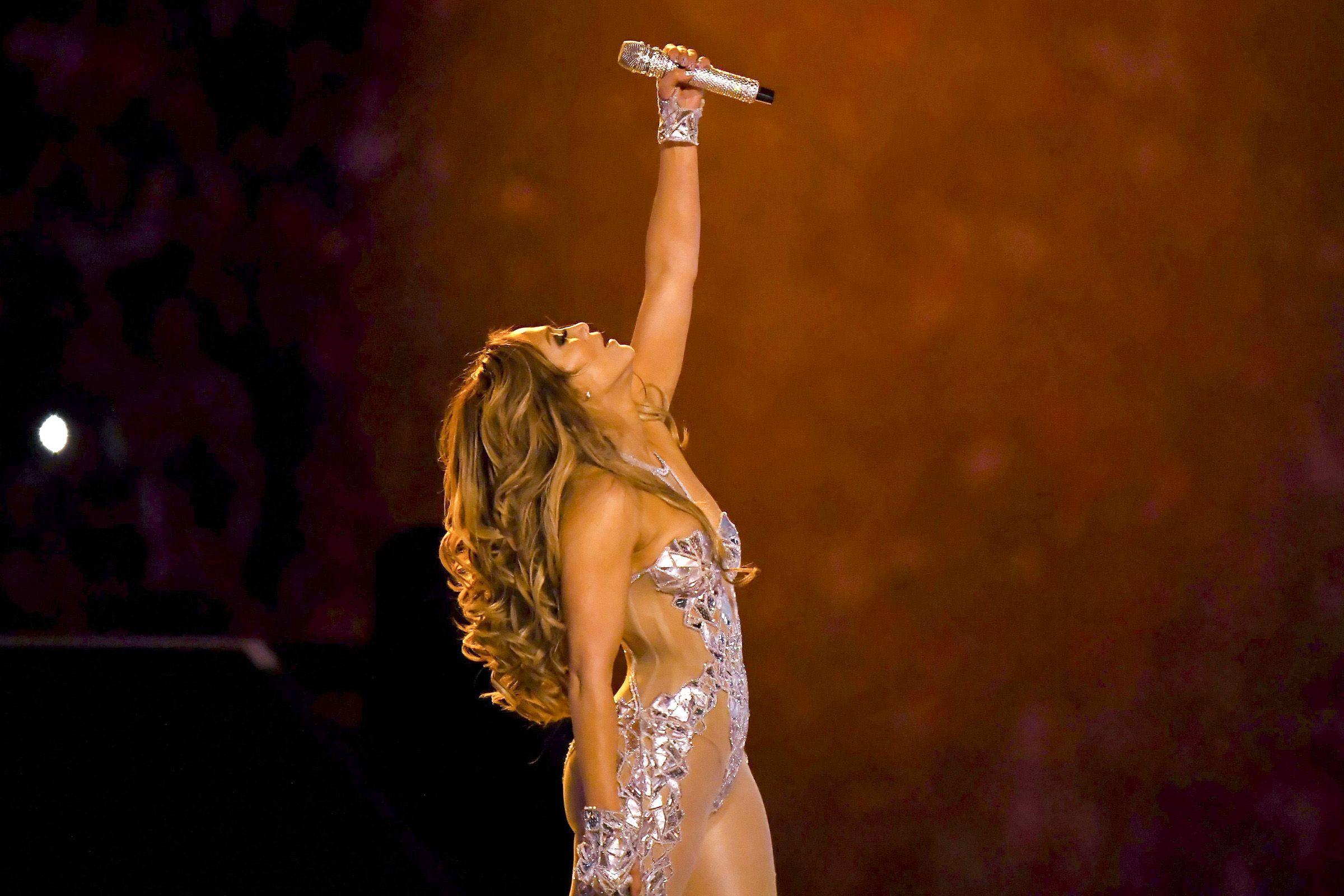 Super Bowl 2020: All About Jennifer Lopez's 5 Halftime Show Outfit Changes in 2020   Jennifer lopez. White bralette top. Super bowl fashion