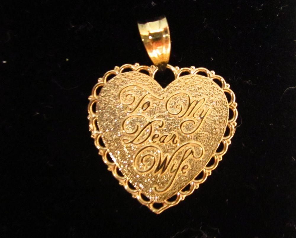 Coach leather lexi style f silvergraphite heart pendant