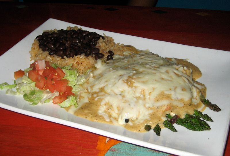 Crab and Asparagus Enchiladas: lump crab and grilled asparagus with Cajun crab, soft corn tortillas, and cheese.