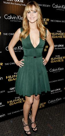 Jennifer Lawrence took the plunge in a forest green Calvin Klein Collection dress and strappy Jimmy Choo sandals at the Cinema Society screening of The Hunger Games.