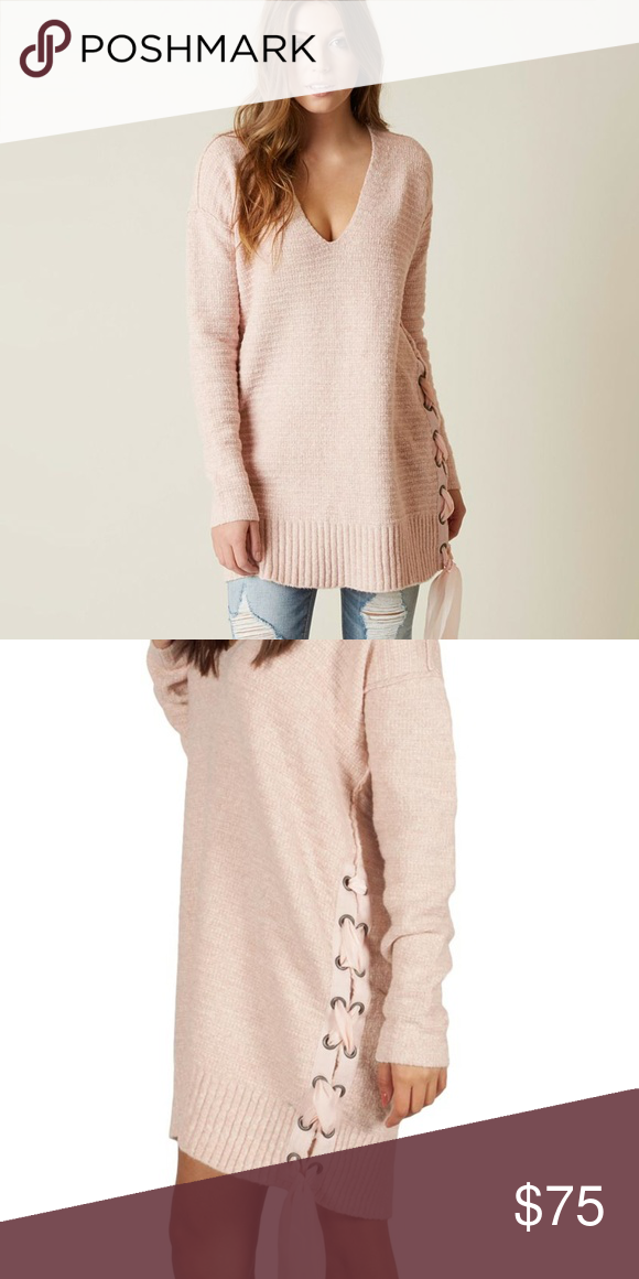 8339dd22154 Free People Heart It Laces Sweater Super soft light pink V neck sweater  that is tunic length and has a ribbon tie up detail on the side.Exposed  seams.
