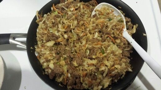Crack Slaw. My first attempt. Sooo good! Brown 1 lb. ground turkey, or chicken or lean hamburger. Remove from pan and drain any grease. Set meat aside .In same pan, with up to 2 Tbls. Olive oil or toasted sesame oil, saute 2 cloves garlic (I used garlic paste), one 14 oz. bag coleslaw or shredded cabbage, 3 green onions sliced, until cabbage is cooked to desired tenderness. Stir in meat and sauce made from: 1/4 teas. Splenda, 1/2 teas. Ginger paste, 1 teas. Rice or white vinegar, 2Tbls. Soy…