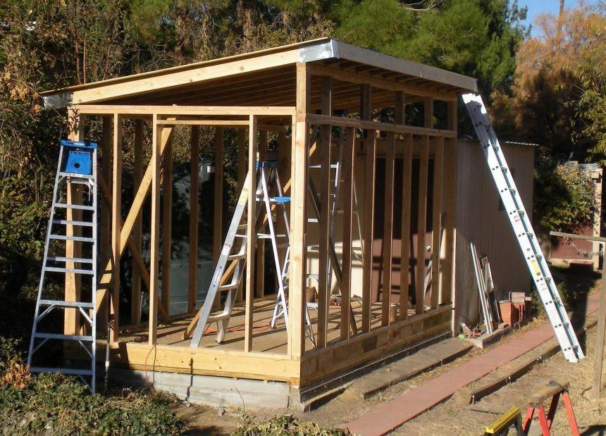 garden summer house building raised with logs the