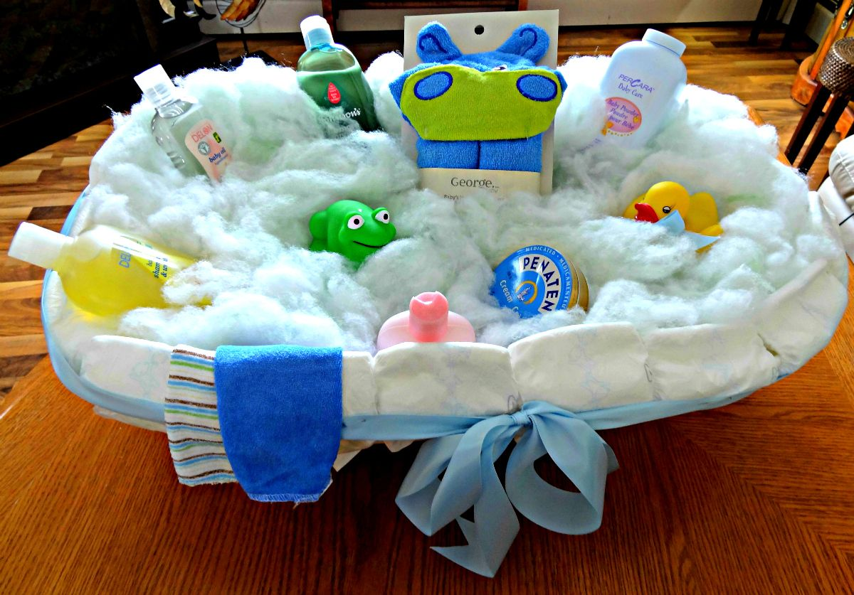 the baby tub gift i made before i wrapped it i bought a baby tub put newborn diapers around. Black Bedroom Furniture Sets. Home Design Ideas