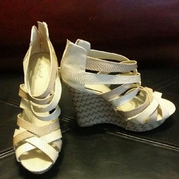 Size 10 tan wedges Size 10 tan  peep toe wedges. Brand New, never worn. Zip up back. Qupid Shoes Wedges