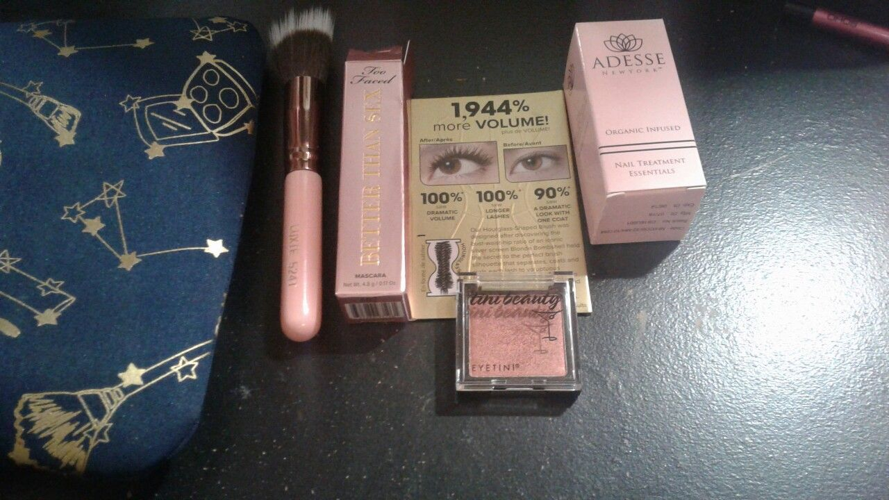 """Left to right:  New makeup baggie,  small stippling brush. """"Better than sex"""" mascara, """"firestarter""""shadow  by tini beauty, & Nail treatment by Adesse New York"""