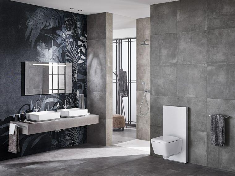 Sanitari moderni monoblocco da bagno su una parete con piastrelle