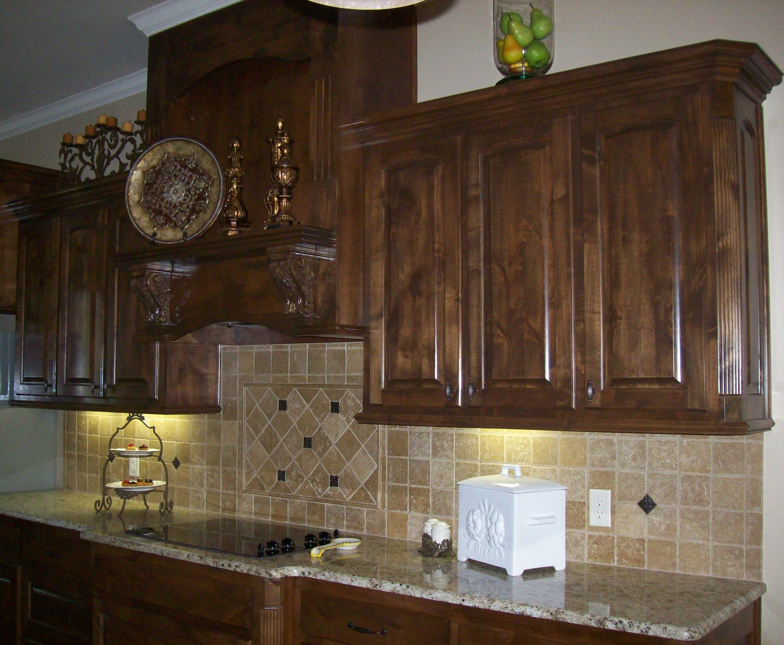 Knotty alder dark walnut stain pictures to pin on for Darken kitchen cabinets
