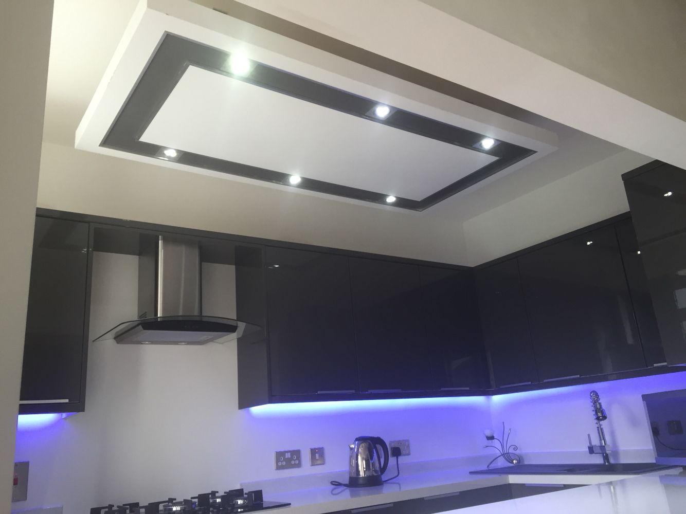 Kitchen lighting. LED strips under cabinets and on kick ...