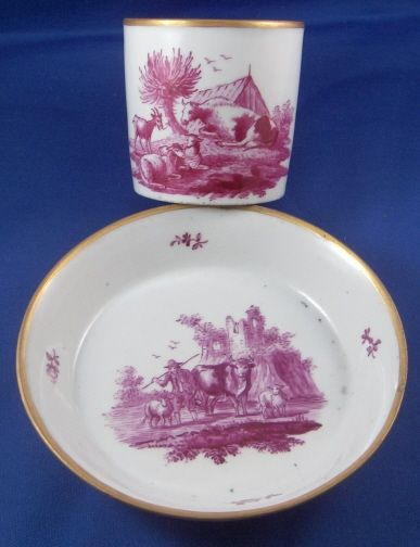 Korzec Scenic Cup & Saucer. This is a cup and saucer made by Korzec in the very beginning of the 19th century. Korzec was started by Joseph Klemens Prince Czartoryski in 1790 and made porcelain until about the mid 19th century.