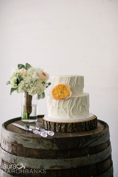 Two-tier white frosted wedding cake. Tree bark wedding cake stand ...