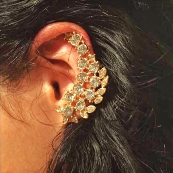 Sparkling Ear Piece Great piece destined to place all eyes on you! Style with a casual dress or an elegant outfit! Can be paired with other earrings or hold its own. Designed for a piercing on the bottom and clip-on in the top. One per order. Jewelry Earrings