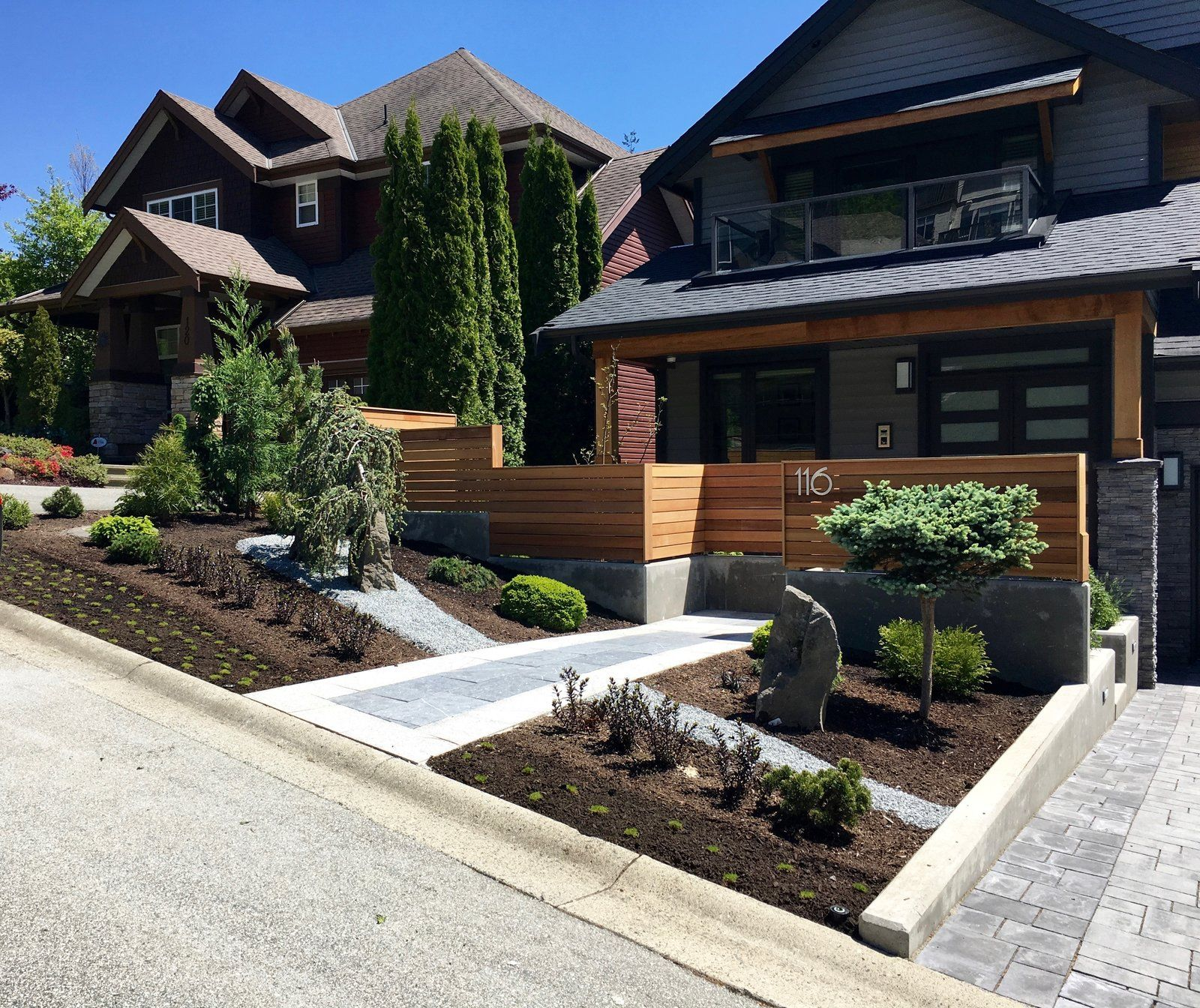 Modern Home With Outdoor Front Yard Slope Trees Shrubs
