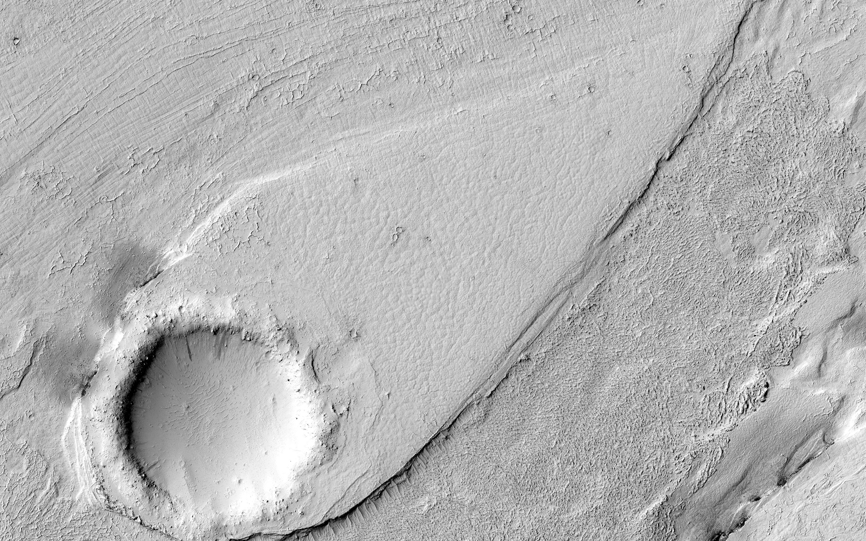 September 13 2016 : A Streamlined Form in Lethe Vallis Mars This image shows a portion of Lethe Vallis an outflow channel that also transported lava. This is one of only a few places on Mars where these pristine-appearing landforms have been identified. The channel formed by catastrophic floods during which it produced the prominent crater-cored teardrop-shaped island in the middle.