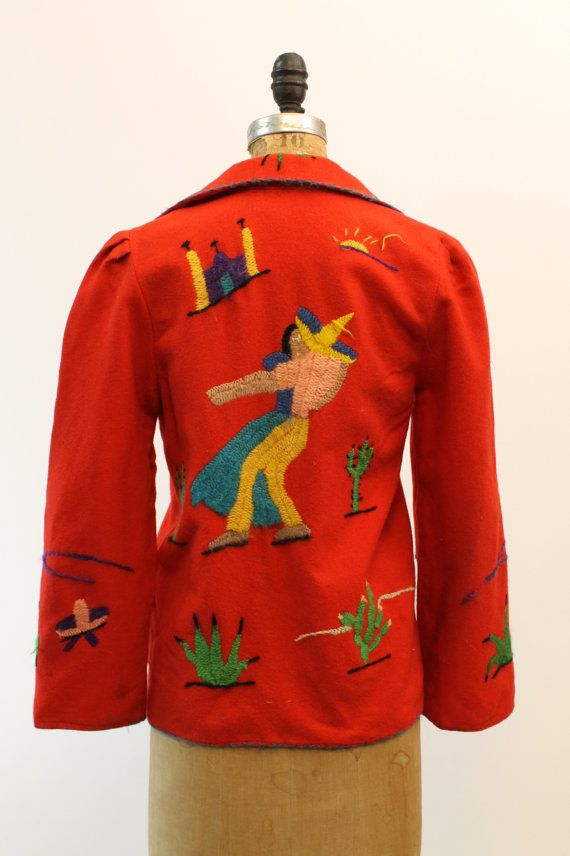 Gorgeous iconic 40s Souvenir jacket! Done in a thin felted bright red wool. Fully hand embroidered. Sweet gathered shoulders. Two front pockets.