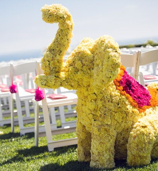 These elephants used more than 1,500 yellow carnations for the body, and orange marigolds and fuchsia pink carnations for each of the elephants blankets