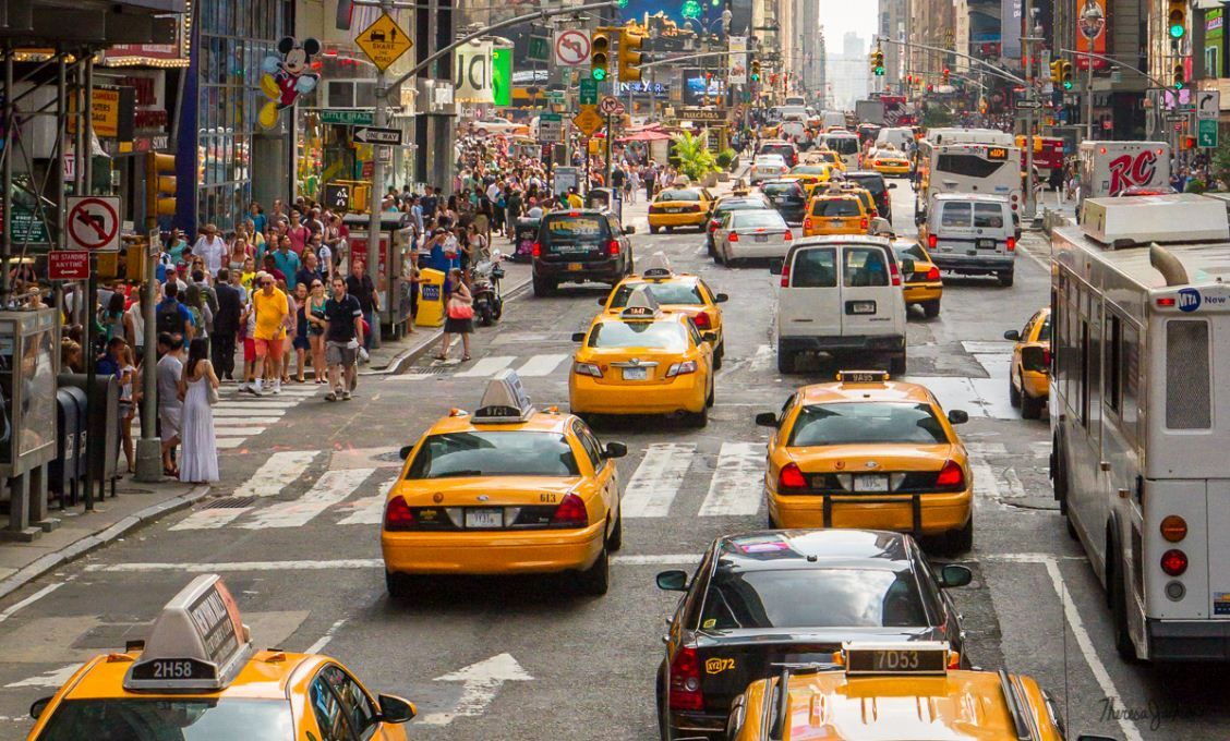 Why are Taxicabs of New York City often painted yellow?