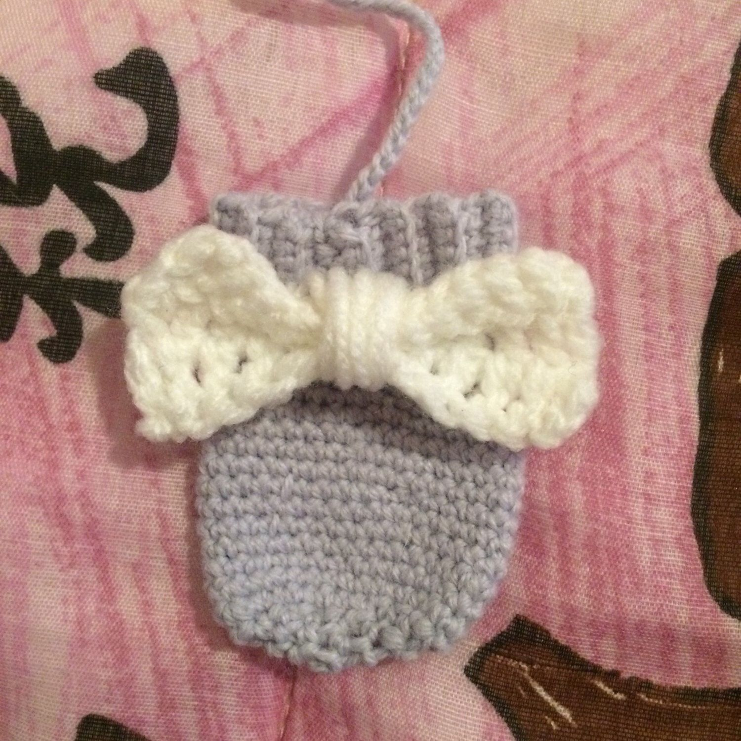 A personal favourite from my Etsy shop https://www.etsy.com/au/listing/487507124/infant-scratch-mittens-with-bow