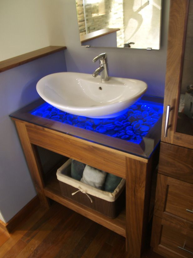diy vanity nightlight pebbles are set below a clear glass countertop and illuminated with blue. Black Bedroom Furniture Sets. Home Design Ideas