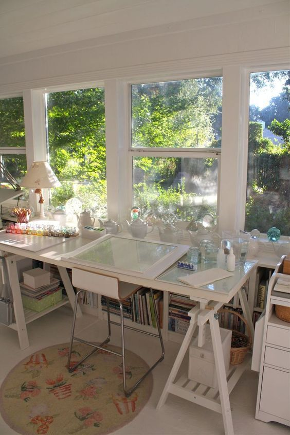 There's something so peaceful about a white studio with natural sunlight pouring in and beautiful greenery outside. Inspirational space for sure. #homeoffice #studio #artstudio #officespace #naturalsunlight #workfromhome