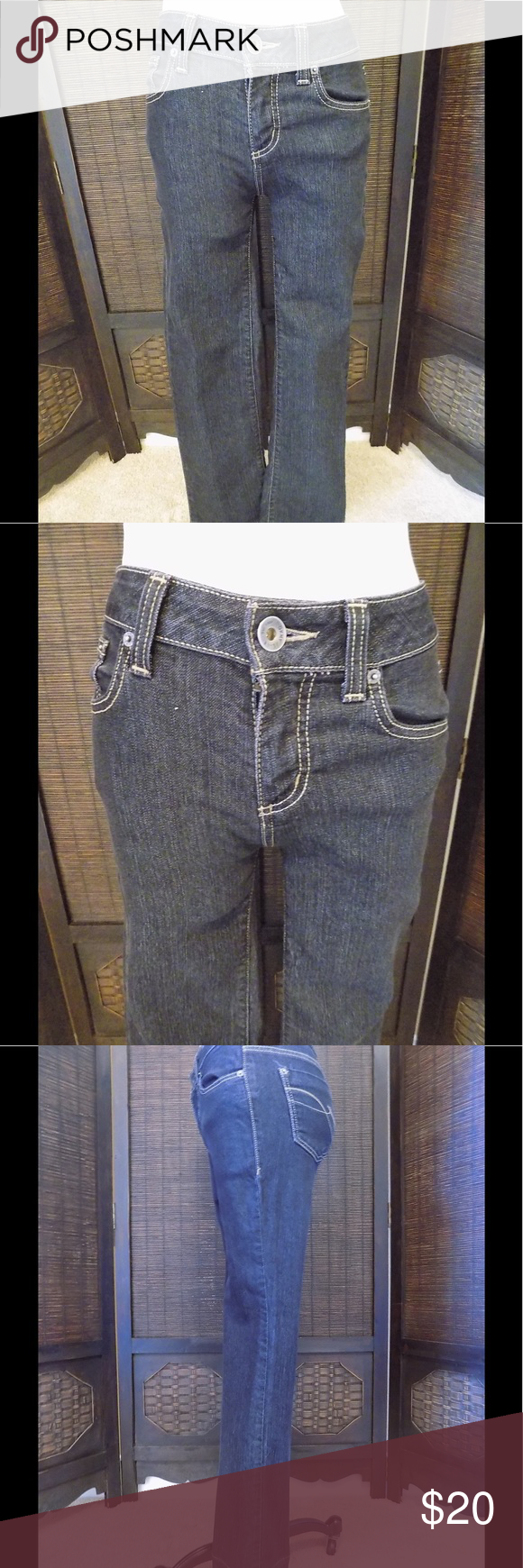 """DKNY Soho Jean Size 2R Nice pair of DKNY SOHO Jeans.  Size 2R.  71% cotton, 28% polyester and 1% spandex.  Dark wash.  In terrific condition.  Measurements are: 28"""" waist, 35"""" hip, 9"""" rise and 31"""" inseam.  Bootcut. DKNY Jeans Boot Cut"""