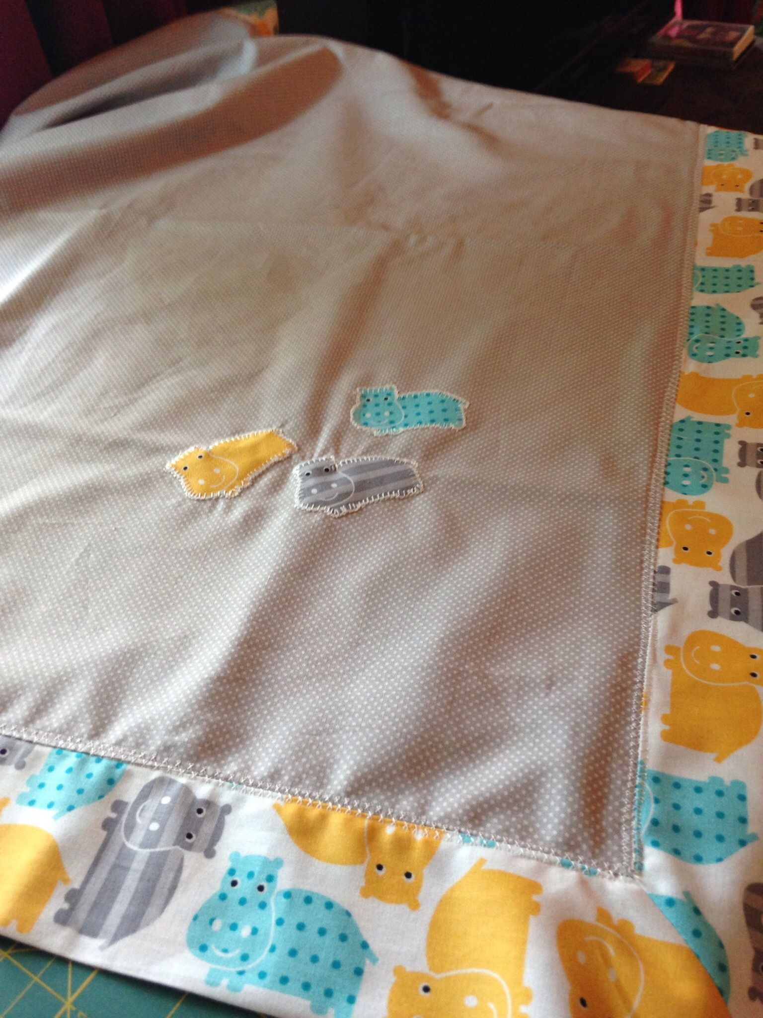 Self binding baby quilt with appliqué made for a friend