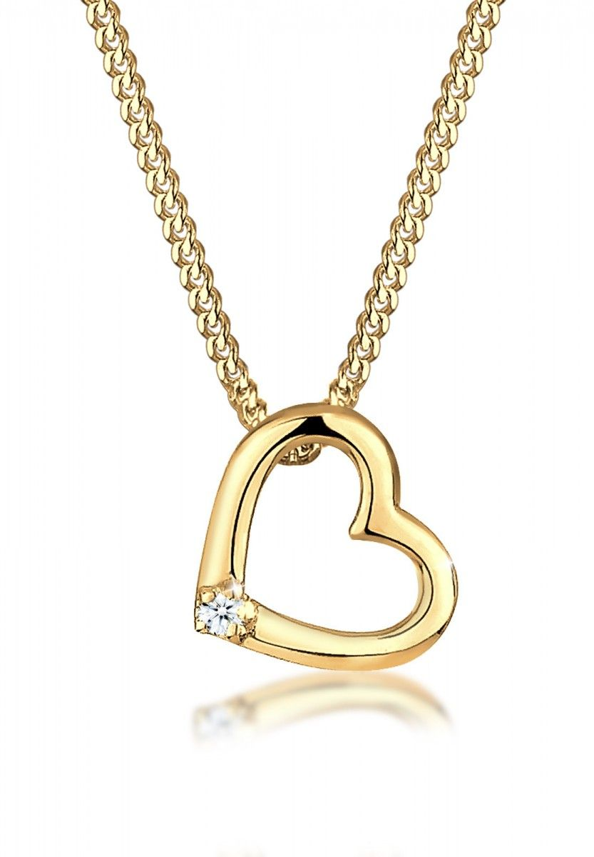 Ellie by JULIE & GRACE loves this gold heart necklace.