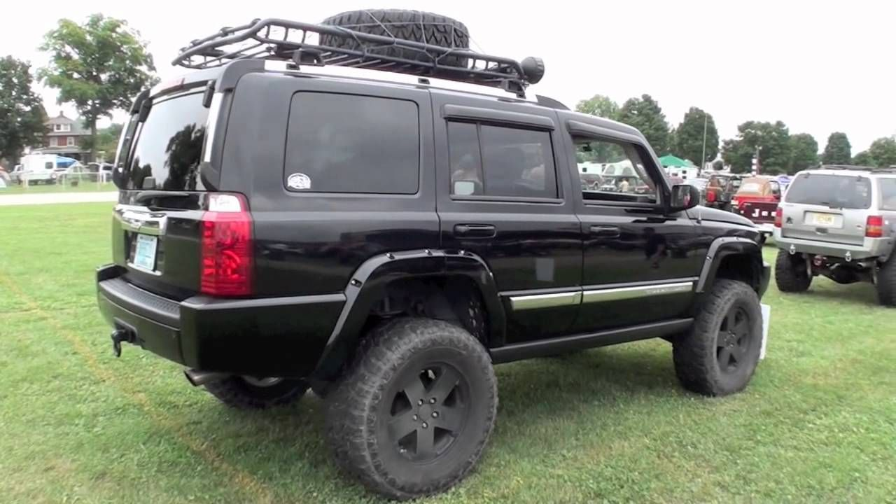 my jeep commander with rough country lift kit, mickey thompson