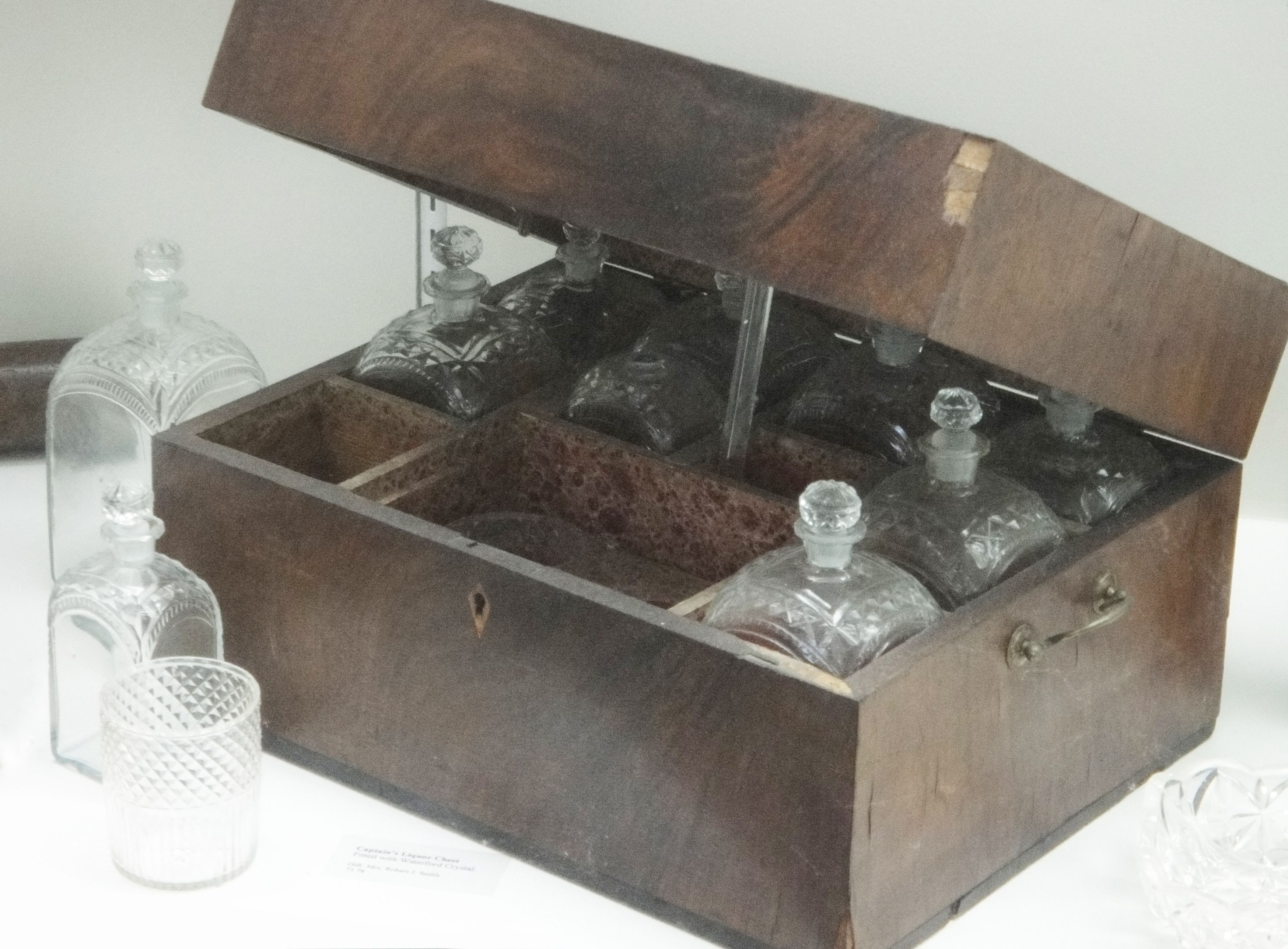 a handsome liquor chest with beautifully crafted waterford crystal