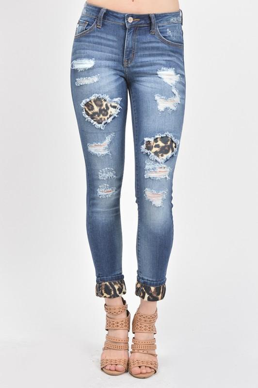 78f5ffc34a61 KanCan Distressed Jeans with Leopard Patchwork & Cuff 70% Cotton, 19%  Polyester, 10% Rayon, 1% Lycra Front Rise 8.5