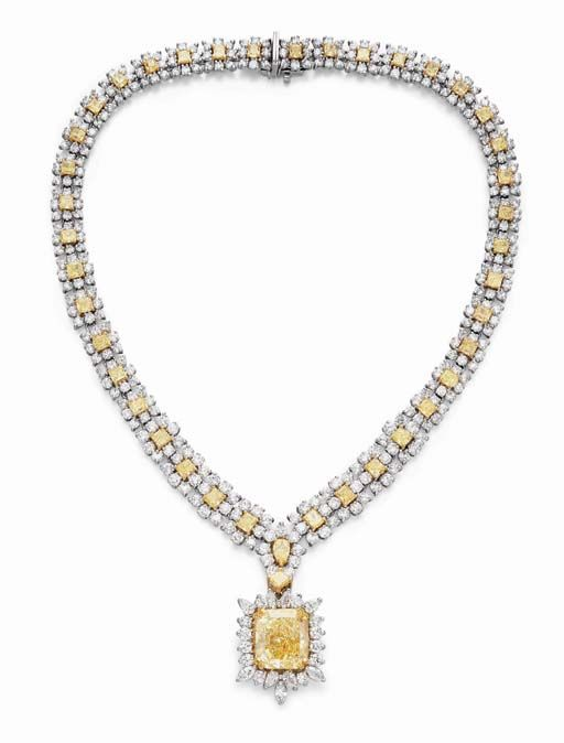 COLORED DIAMOND PENDANT NECKLACE   Suspending a modified rectangular-cut fancy yellow diamond, weighing approximately 30.06 carats, within a vari-cut diamond surround, joined by a square and marquise-cut yellow diamond and diamond foliate link, to the square-cut yellow diamond and circular-cut diamond floret band, mounted in platinum and gold