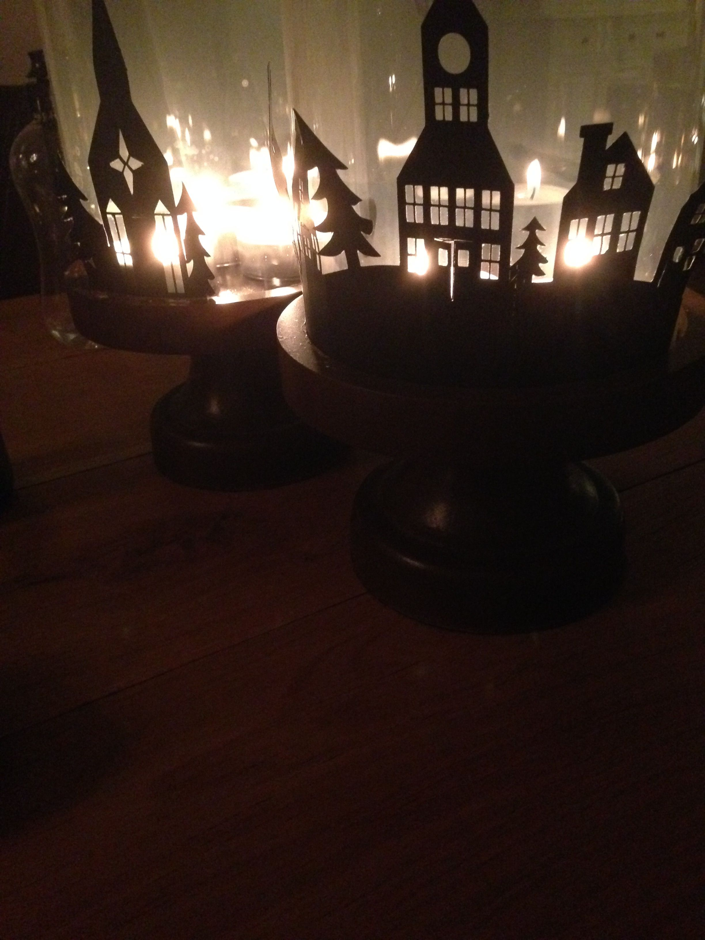 I bought the design at the Silhouette online store and wrapped it around my own candle holders. It's such a lovely touch for this season.