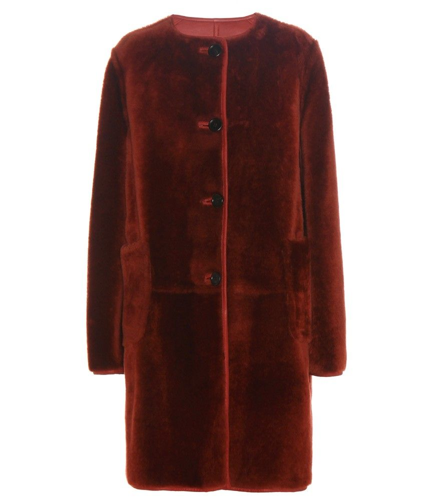 Marni - Reversible fur coat - Expertly crafted in Italy from plush sheepskin, Marni opts for a luxurious look for the new season with this striking coat. The collarless design can be worn with either the fur or reversed with leather side showing – a versatile quality that makes this rich burgundy design a worthwhile investment piece. Let the label's retro style guide you and wear yours with a pair of wide-leg trousers. seen @ www.mytheresa.com