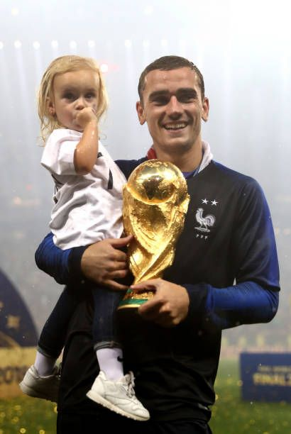 Antoine Griezmann of France celebrates victory with daughter Mia following the 2018 FIFA World Cup Final between France and Croatia at Luzhniki...