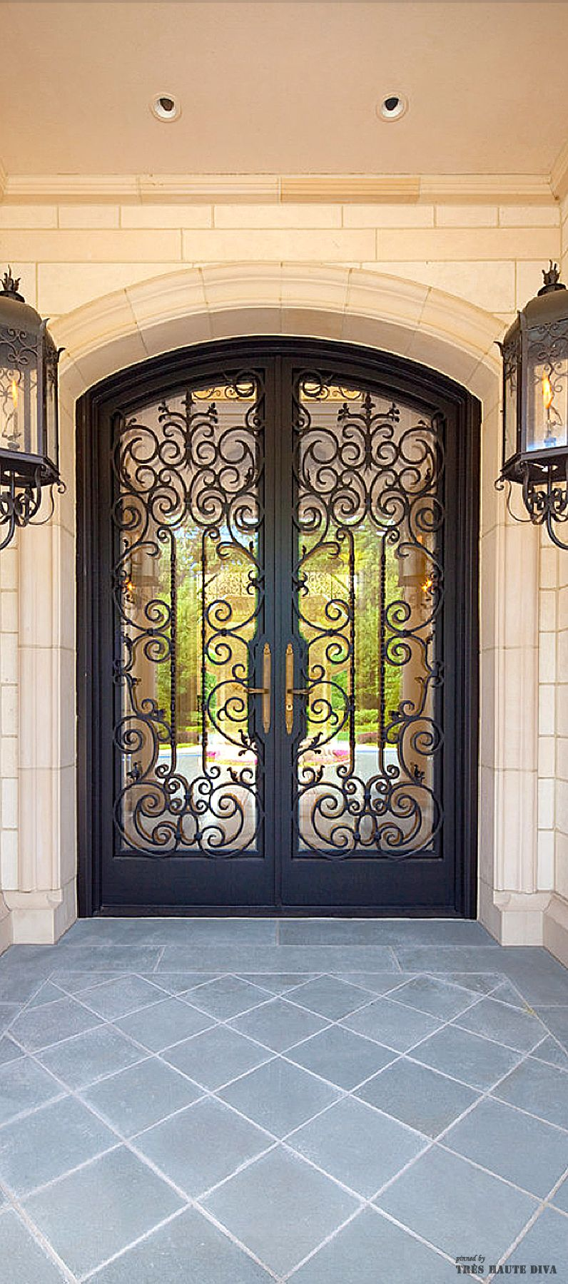Custom Wrought Iron door and lanterns | Versatility Of Sliding ...