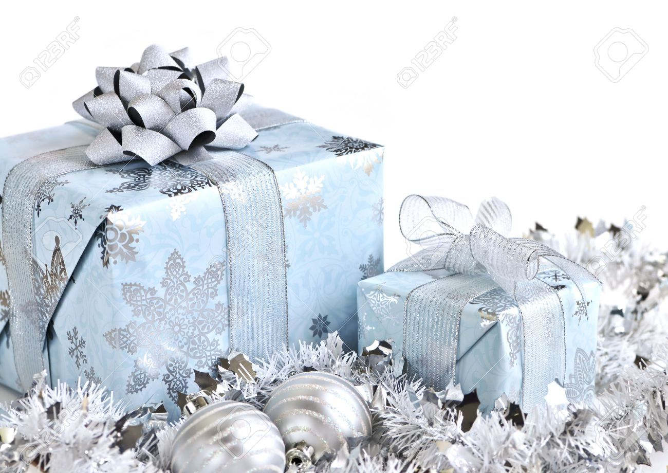Wrapped Gift Boxes With Silver Christmas Ornaments On White ...