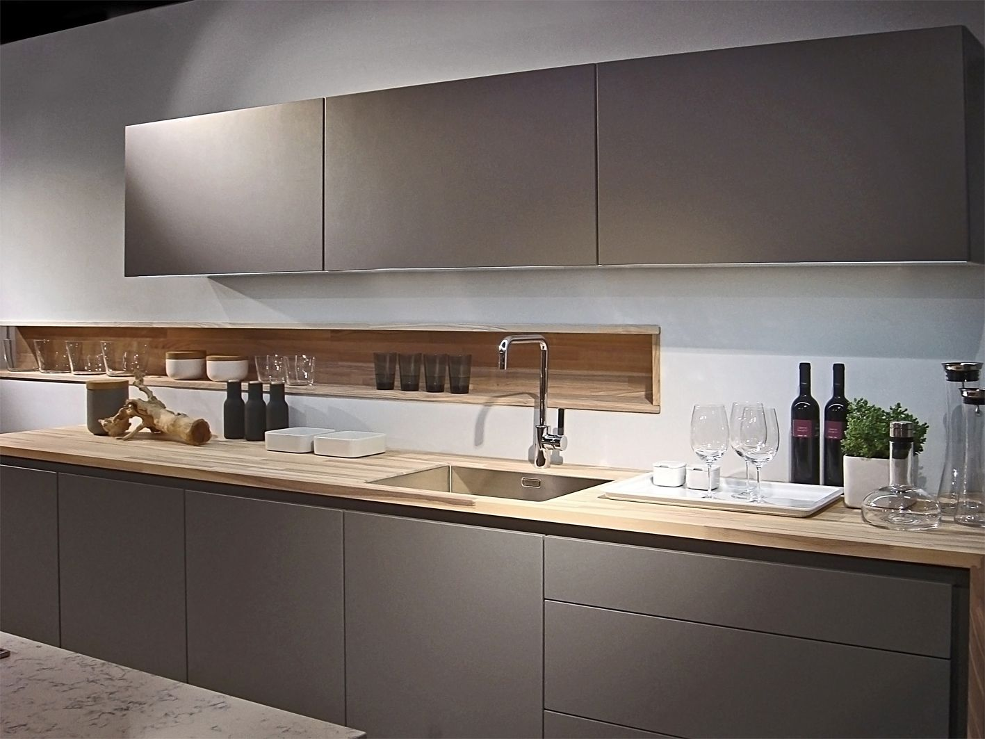 """""""A grey that contrary to what already existed could combine with warmer colours and get into our cosy kitchens, even warmer and inviting environments."""" - affirms Manfred Junker, Poggenpohl Chef Designer"""