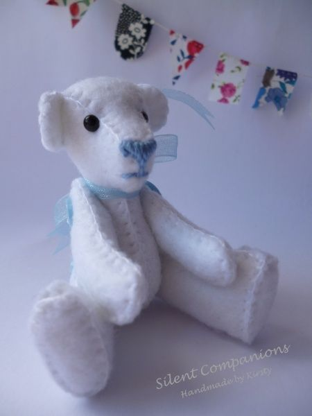 White felt bear with blue buttons £25.00