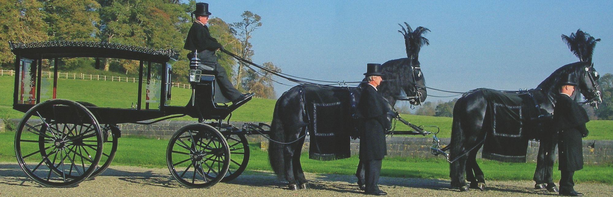 Horse drawn hearse with 4 horses.