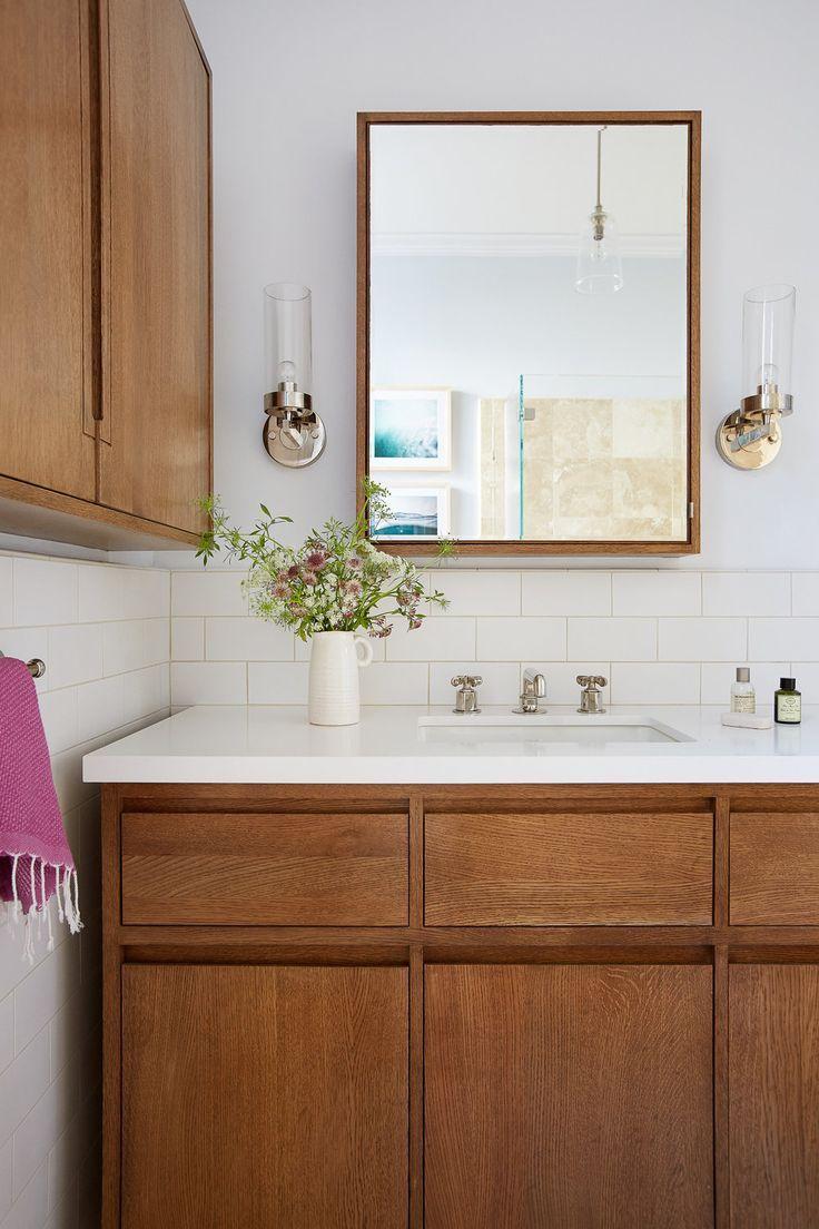 White ad wood bathroom design with white subway tile | Lauren Nelson ...